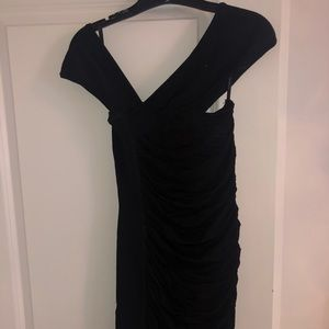 bebe Dresses - BEBE black mini dress.